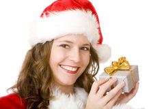 Happy Santa woman holding Christmas gift box Stock Photography
