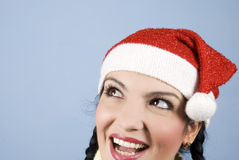 Happy Santa woman looking upper left. Head shot of beautiful Santa woman smiling and show a surprised face and looking sideways upper left corner  to copy space Stock Photo
