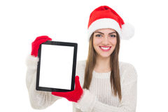 Happy Santa young woman showing tablet computer Stock Images