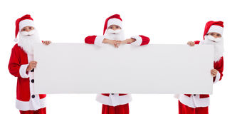 Happy santas holding blank banner Royalty Free Stock Image