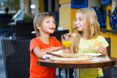 Happy or satisfied boy width girl eating pizza and Stock Images