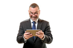 Happy satisfied businessman holding a tablet stock photo