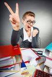 Happy satisfied businesswoman in office. Royalty Free Stock Photography