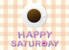 'Happy Saturday' letters and a cup of coffee on grey fabric background. Stock Photo