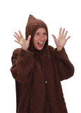 Happy scared woman. Woman wearing winter clothes isolated against a white background Royalty Free Stock Photography