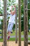 Happy school boy enjoying playground Royalty Free Stock Photography