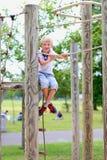 Happy school boy enjoying playground Stock Photo