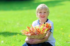 Happy school boy holding basket full of Easter eggs Royalty Free Stock Image