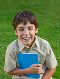 Happy school boy  with note book Royalty Free Stock Images