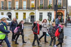 Happy school boys and girls in London royalty free stock image