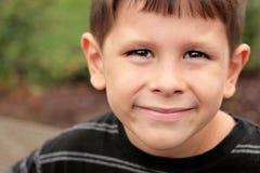 Happy school child joyful face. Happy joyful boy with smiling eyes and joyful face Royalty Free Stock Images