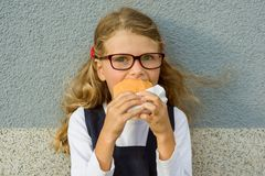 Happy school child with lunch. Royalty Free Stock Photography