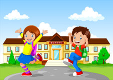 Happy school children with backpack on school building background Royalty Free Stock Image