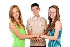 Happy school children holding hands Stock Photos