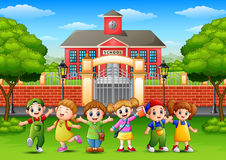 Happy school children standing in front of school building. Illustration of Happy school children standing in front of school building Stock Photography
