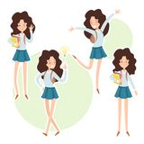 Happy school girl with a books in hand. royalty free stock photo