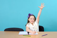 Happy school girl in classroom Stock Photo