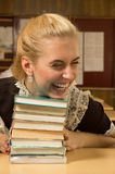 Happy school girl at her desk Stock Images