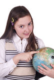 Happy school girl holding globe Stock Photos