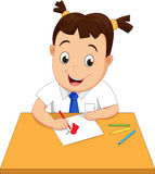 Happy school girl making a drawing on a paper Royalty Free Stock Photo