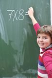 Happy school girl on math classes. Finding solution and solving problems Royalty Free Stock Photography