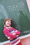 Happy school girl on math classes. Finding solution and solving problems Stock Photography