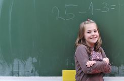 Happy school girl on math classes. Finding solution and solving problems Royalty Free Stock Photo