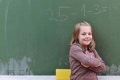 Happy school girl on math classes. Finding solution and solving problems Royalty Free Stock Photos