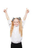 Happy school girl showing thumbs up symbol. Isolated on white background Royalty Free Stock Photos