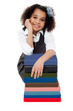 Happy school girl with stack of books Stock Photo