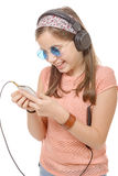 Happy school girl texting to someone. Royalty Free Stock Photo