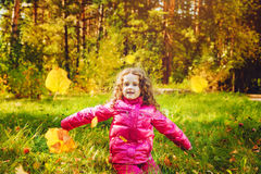 Happy school girl throws the autumn leaves in the air. Instagram Royalty Free Stock Images