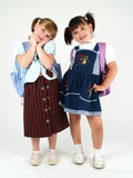Happy school girls. With backpacks Royalty Free Stock Photo