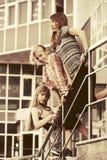 Happy school girls on steps. Group of happy school girls on steps Stylish teenage model Royalty Free Stock Photography