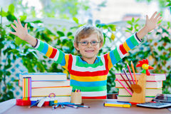 Happy school kid boy with glasses and student stuff Stock Images