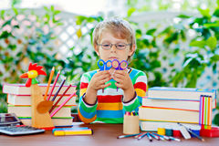 Happy school kid boy with glasses and student stuff Royalty Free Stock Images