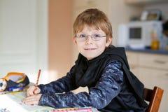 Happy school kid boy at home making homework Royalty Free Stock Photo