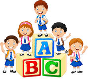 Happy school kids with alphabet blocks Stock Photos