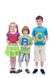 Happy school kids holding large abc letters. Learning concept royalty free stock image