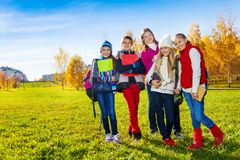 Happy school kids in park Stock Photography