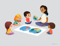 Happy school kids and teacher sit in circle around atlas. And discuss geographical questions during lesson. Preschool activities concept. Vector illustration royalty free illustration
