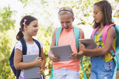 Happy school kids using digital tablet Royalty Free Stock Images