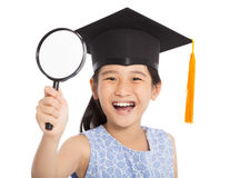 Happy school little girl holding magnifier Stock Image