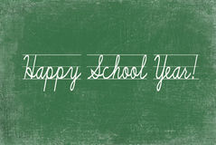 Happy School Year. Perfect penmanship on green chalkboard Royalty Free Stock Photography