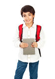 Happy schoolboy. Isolated on white background, cute brunet teenager with red backpack standing and holding book, pretty schoolkid wearing casual clothes, back Royalty Free Stock Photography