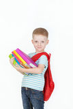 Happy schoolboy with backpack and books isolated on white background Stock Photos