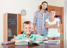 Happy schoolboy doing homework Royalty Free Stock Photos