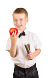 Happy schoolboy holding  pencil and  apple isolated on white background. Royalty Free Stock Photo