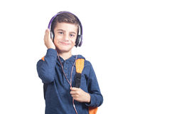 Happy schoolboy listening to music. Isolated on white background. Education concept Royalty Free Stock Photo
