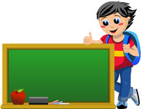 Happy Student Looking at Blackboard with Thumb Up Royalty Free Stock Photography